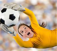 Soccer player catching ball in air Stock Photo - Premium Royalty-Freenull, Code: 614-06719870