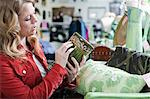 Woman shopping in thrift store Stock Photo - Premium Royalty-Free, Artist: Blend Images, Code: 614-06719950