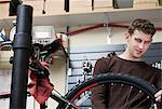 Mechanic working in bicycle repair shop Stock Photo - Premium Royalty-Free, Artist: Blend Images, Code: 614-06719977