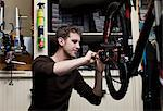 Mechanic working in bicycle repair shop Stock Photo - Premium Royalty-Free, Artist: Blend Images, Code: 614-06719980
