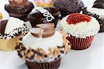 Decorated cupcakes on counter Stock Photo - Premium Royalty-Free, Artist: Cultura RM, Code: 614-06720048