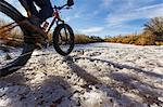 Mountain biker on snow in rural field Stock Photo - Premium Royalty-Free, Artist: Westend61, Code: 614-06720096