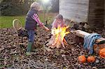 Children building bonfire outdoors Stock Photo - Premium Royalty-Free, Artist: CulturaRM, Code: 6113-06720223