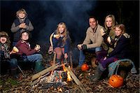 Family eating around campfire at night Stock Photo - Premium Royalty-Freenull, Code: 6113-06720231