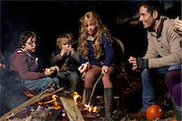 Family eating around campfire at night Stock Photo - Premium Royalty-Freenull, Code: 6113-06720249
