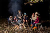Family eating around campfire at night Stock Photo - Premium Royalty-Freenull, Code: 6113-06720251