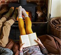 Children relaxing by fire Stock Photo - Premium Royalty-Freenull, Code: 6113-06720262