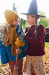 Girls playing with witch's hat and broom outdoors Stock Photo - Premium Royalty-Free, Artist: Uwe Umstätter, Code: 6113-06720268