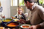 Father and daughter eating together at table Stock Photo - Premium Royalty-Free, Artist: Jean-Christophe Riou, Code: 6113-06720271