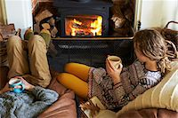 sweater and fireplace - Children drinking cups of tea by fire Stock Photo - Premium Royalty-Freenull, Code: 6113-06720292