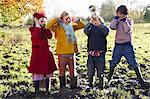 Children covering their ears as boy plays trumpet Stock Photo - Premium Royalty-Free, Artist: CulturaRM, Code: 6113-06720295
