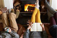 Children relaxing by fire Stock Photo - Premium Royalty-Freenull, Code: 6113-06720300