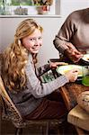 Smiling girl eating at table Stock Photo - Premium Royalty-Free, Artist: Photocuisine, Code: 6113-06720322