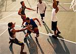 Men playing basketball on court Stock Photo - Premium Royalty-Free, Artist: Blend Images, Code: 6113-06720361