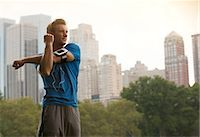 Runner stretching in urban park Stock Photo - Premium Royalty-Freenull, Code: 6113-06720372