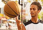 Man spinning basketball on finger Stock Photo - Premium Royalty-Free, Artist: Robert Harding Images, Code: 6113-06720385