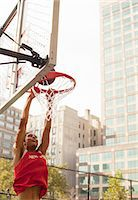 Man dunking basketball on court Stock Photo - Premium Royalty-Freenull, Code: 6113-06720396