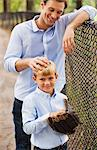 Father and son in baseball field Stock Photo - Premium Royalty-Free, Artist: Cultura RM, Code: 6113-06720424