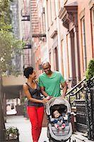 pushing - Family walking together on city street Stock Photo - Premium Royalty-Freenull, Code: 6113-06720472