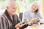 Older couple testing blood sugar together Stock Photo - Premium Royalty-Free, Artist: Cultura RM, Code: 6113-06720583