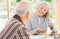 Caucasian couple organizing pills Stock Photo - Premium Royalty-Freenull, Code: 6113-06720596