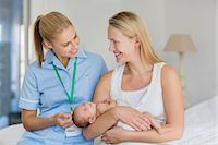 Mother and nurse with newborn baby Stock Photo - Premium Royalty-Freenull, Code: 6113-06720643