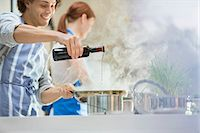 Couple cooking in kitchen Stock Photo - Premium Royalty-Freenull, Code: 6113-06720678