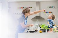 sucking - Father and son cooking in kitchen Stock Photo - Premium Royalty-Freenull, Code: 6113-06720680