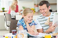 Father and daughter having breakfast Stock Photo - Premium Royalty-Freenull, Code: 6113-06720704