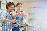 Couple cooking in kitchen Stock Photo - Premium Royalty-Freenull, Code: 6113-06720722
