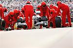 Race car team working at pit stop Stock Photo - Premium Royalty-Free, Artist: Westend61, Code: 6113-06720727