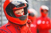 Racer tying on helmet on track Stock Photo - Premium Royalty-Freenull, Code: 6113-06720741