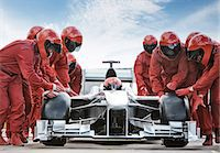 race track (people) - Racing team working at pit stop Stock Photo - Premium Royalty-Freenull, Code: 6113-06720748