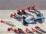 Racing team working at pit stop Stock Photo - Premium Royalty-Free, Artist: Ed Gifford, Code: 6113-06720790