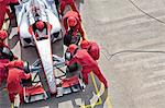 Racing team working at pit stop Stock Photo - Premium Royalty-Free, Artist: Westend61, Code: 6113-06720802
