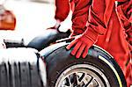 Mechanic working at pit stop Stock Photo - Premium Royalty-Free, Artist: Ed Gifford, Code: 6113-06720805