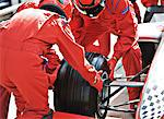 Racing team working at pit stop Stock Photo - Premium Royalty-Free, Artist: Ed Gifford, Code: 6113-06720826