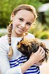 Smiling girl holding guinea pig outdoors Stock Photo - Premium Royalty-Freenull, Code: 6113-06720881