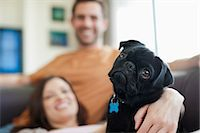 pvg - Couple relaxing with dog on sofa Stock Photo - Premium Royalty-Freenull, Code: 6113-06720970