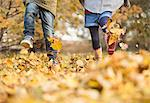Children walking in autumn leaves Stock Photo - Premium Royalty-Free, Artist: CulturaRM, Code: 6113-06721144