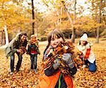 Family playing in autumn leaves Stock Photo - Premium Royalty-Free, Artist: Cultura RM, Code: 6113-06721183