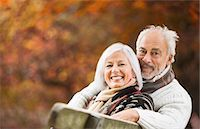 Older couple sitting on park bench Stock Photo - Premium Royalty-Freenull, Code: 6113-06721189