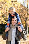 Man carrying son on shoulders in park Stock Photo - Premium Royalty-Free, Artist: Cultura RM, Code: 6113-06721204