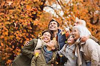 family  fun  outside - Family playing in autumn leaves in park Stock Photo - Premium Royalty-Freenull, Code: 6113-06721209