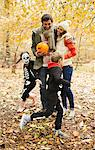 Couple with children in skeleton costumes in park Stock Photo - Premium Royalty-Free, Artist: Science Faction, Code: 6113-06721240