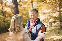 Older couple hugging in park Stock Photo - Premium Royalty-Freenull, Code: 6113-06721248