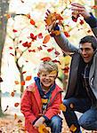 Father and son playing in autumn leaves Stock Photo - Premium Royalty-Free, Artist: ableimages, Code: 6113-06721282