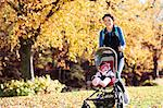 Woman running with baby stroller in park Stock Photo - Premium Royalty-Free, Artist: CulturaRM, Code: 6113-06721321