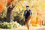 Woman running in park Stock Photo - Premium Royalty-Free, Artist: Aflo Sport, Code: 6113-06721324