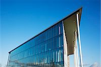 Modern building and blue sky Stock Photo - Premium Royalty-Freenull, Code: 6113-06721420